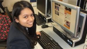 Yasmin reading up on Student News