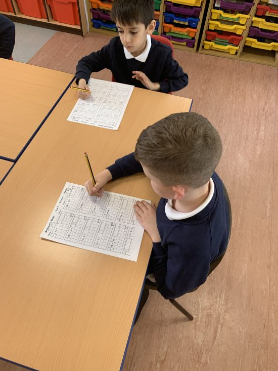 Children in Y2 working on their mental arithmetic test