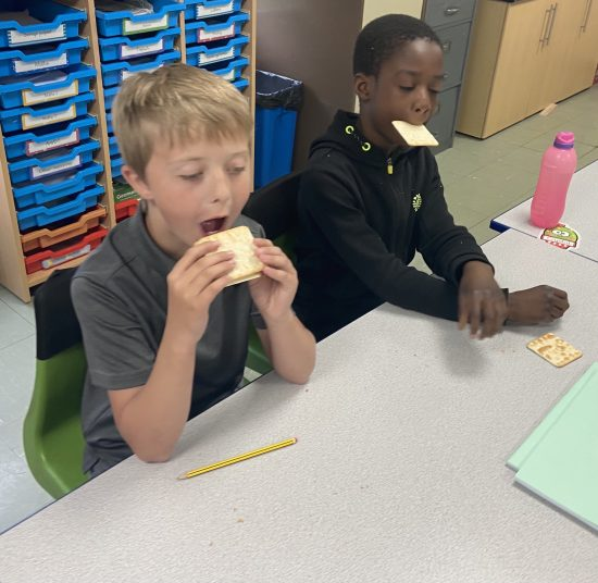Children taking part in the cream cracker challenge