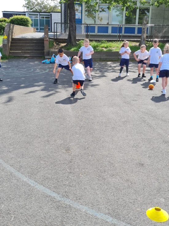 Class 4 playing cricket
