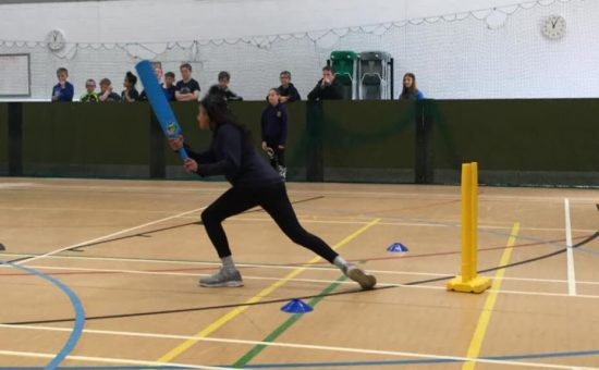 A child steps up to bat at the cricket competition at Castle View