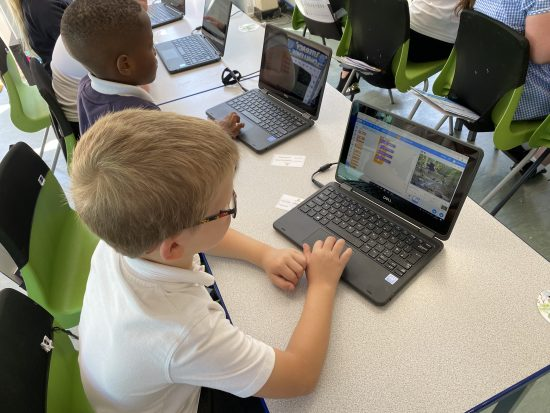 Children working on the new ASDA laptops to create an animation in Scratch