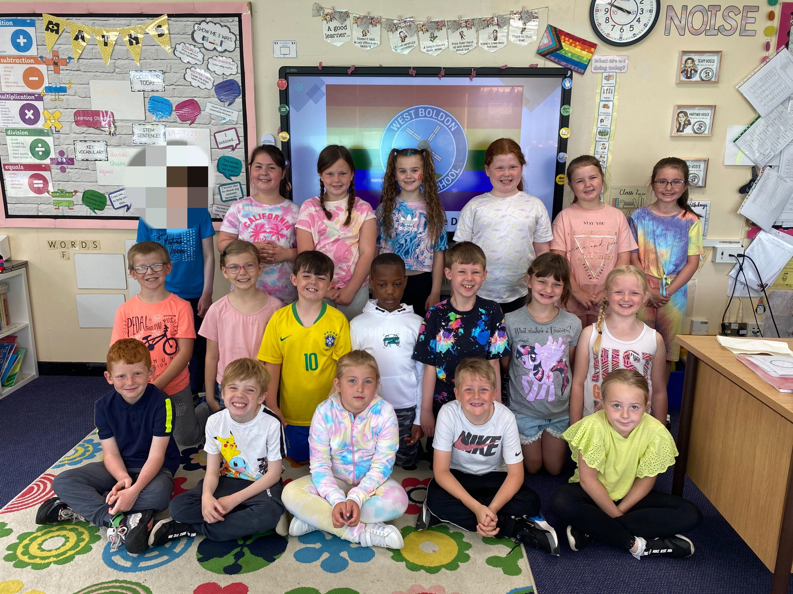 Children in year 3 dressed in bright colours for Diversity Week