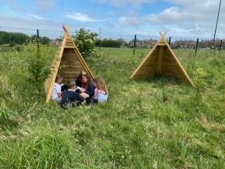 Year 6 children enjoying their lesson in the Secret Garden