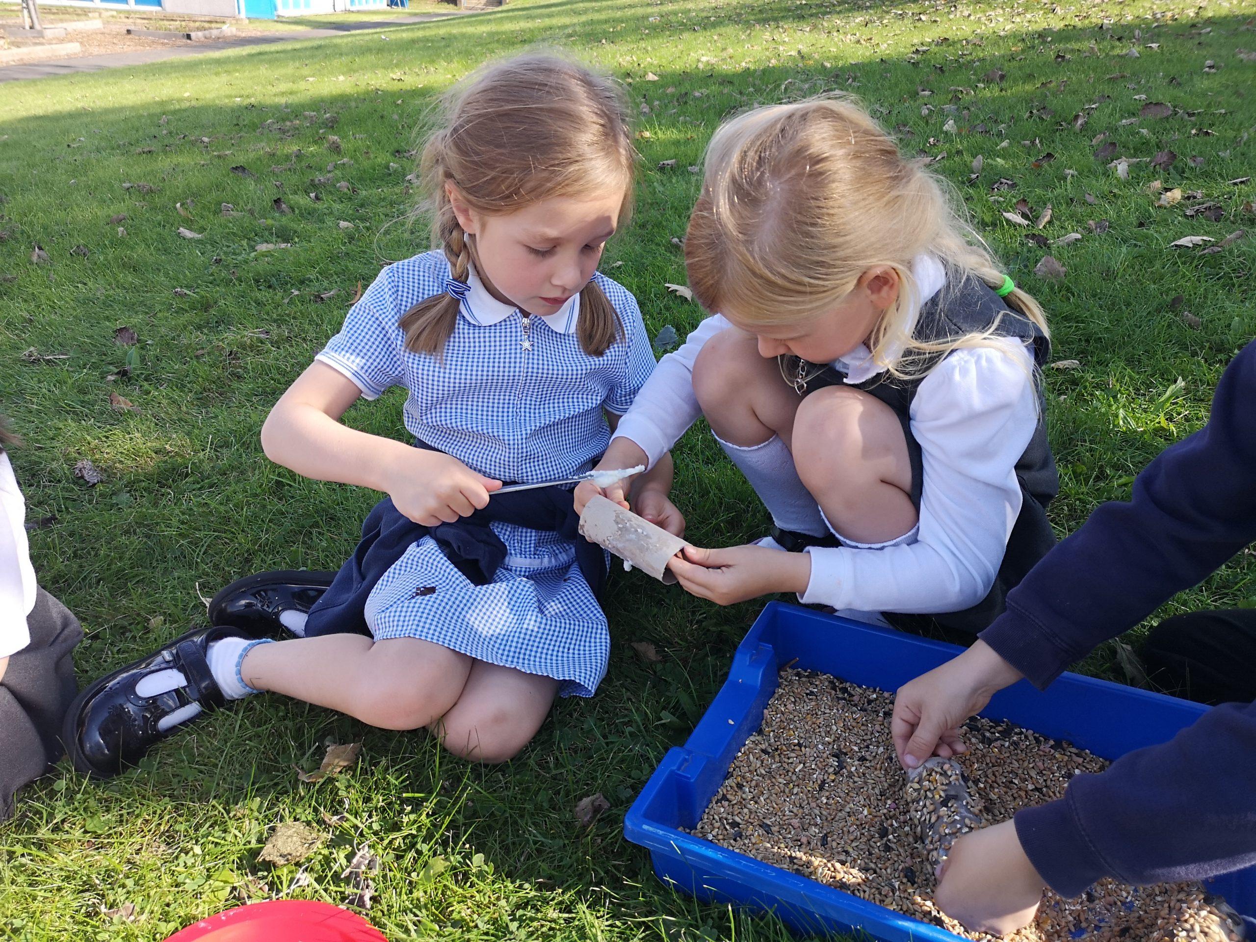 Year 1 children making their bird feeders
