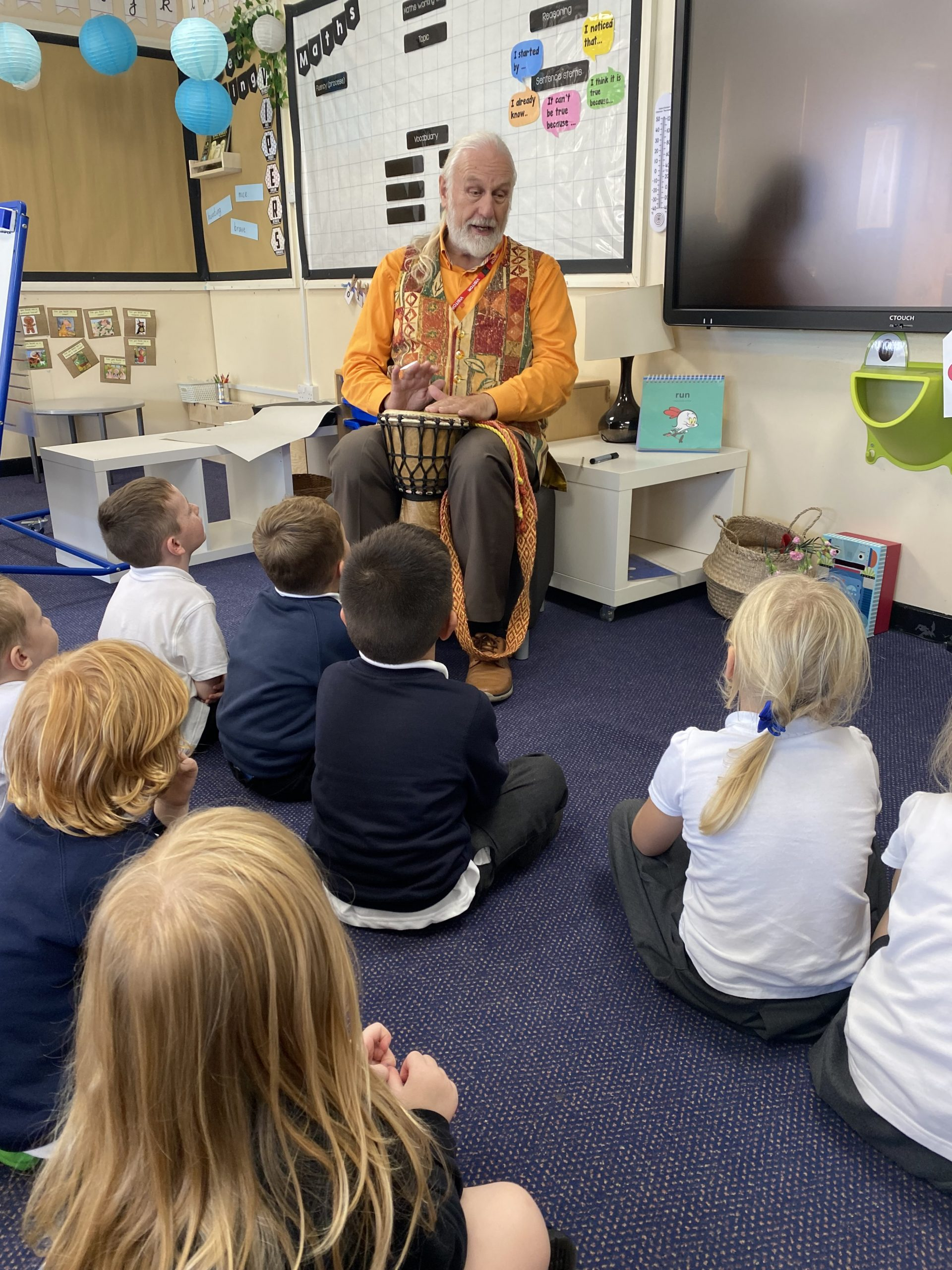 Chris Bostock reading stories to the children in Year 1