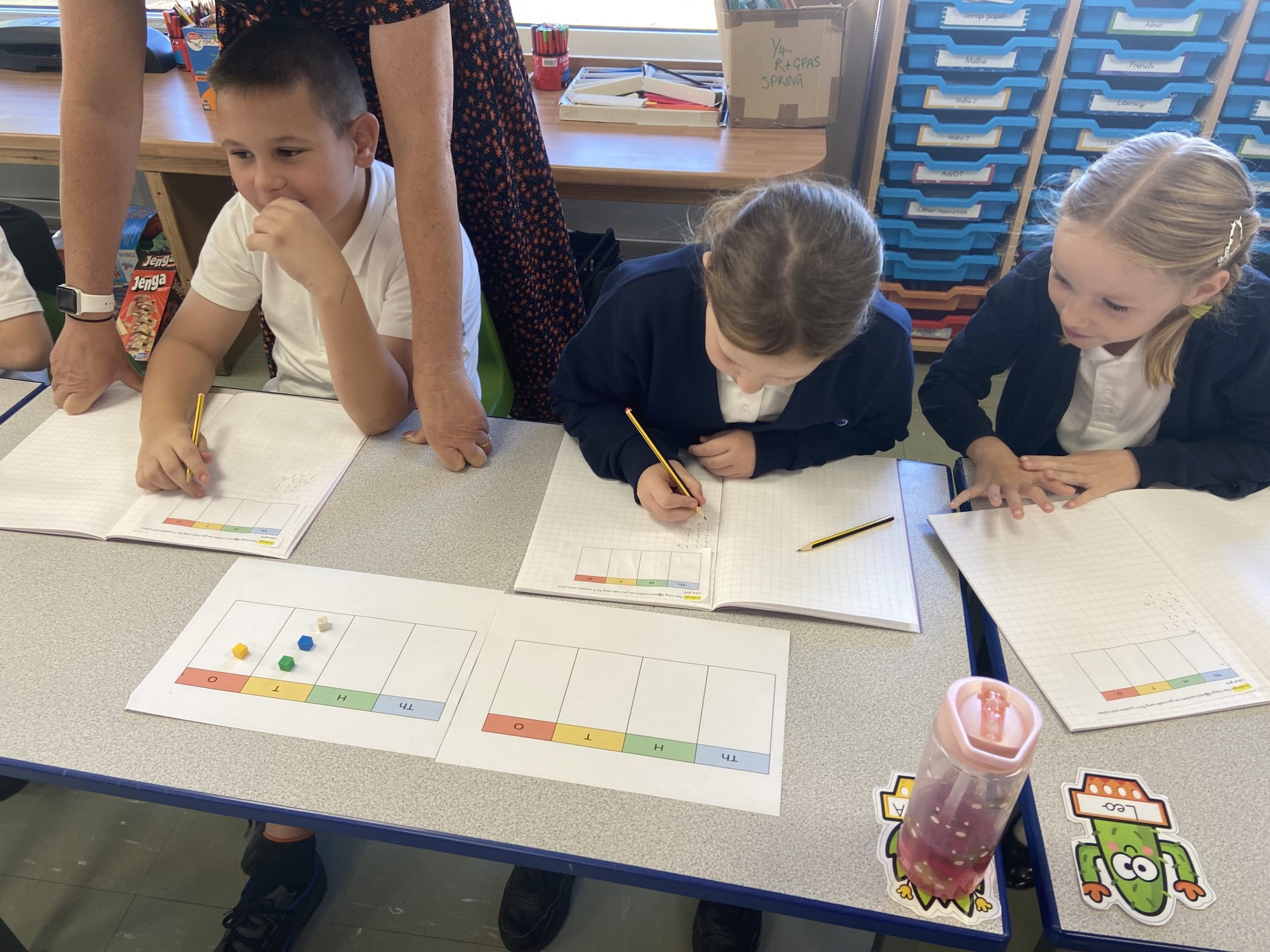 year 4 children practising their place value with practical objects