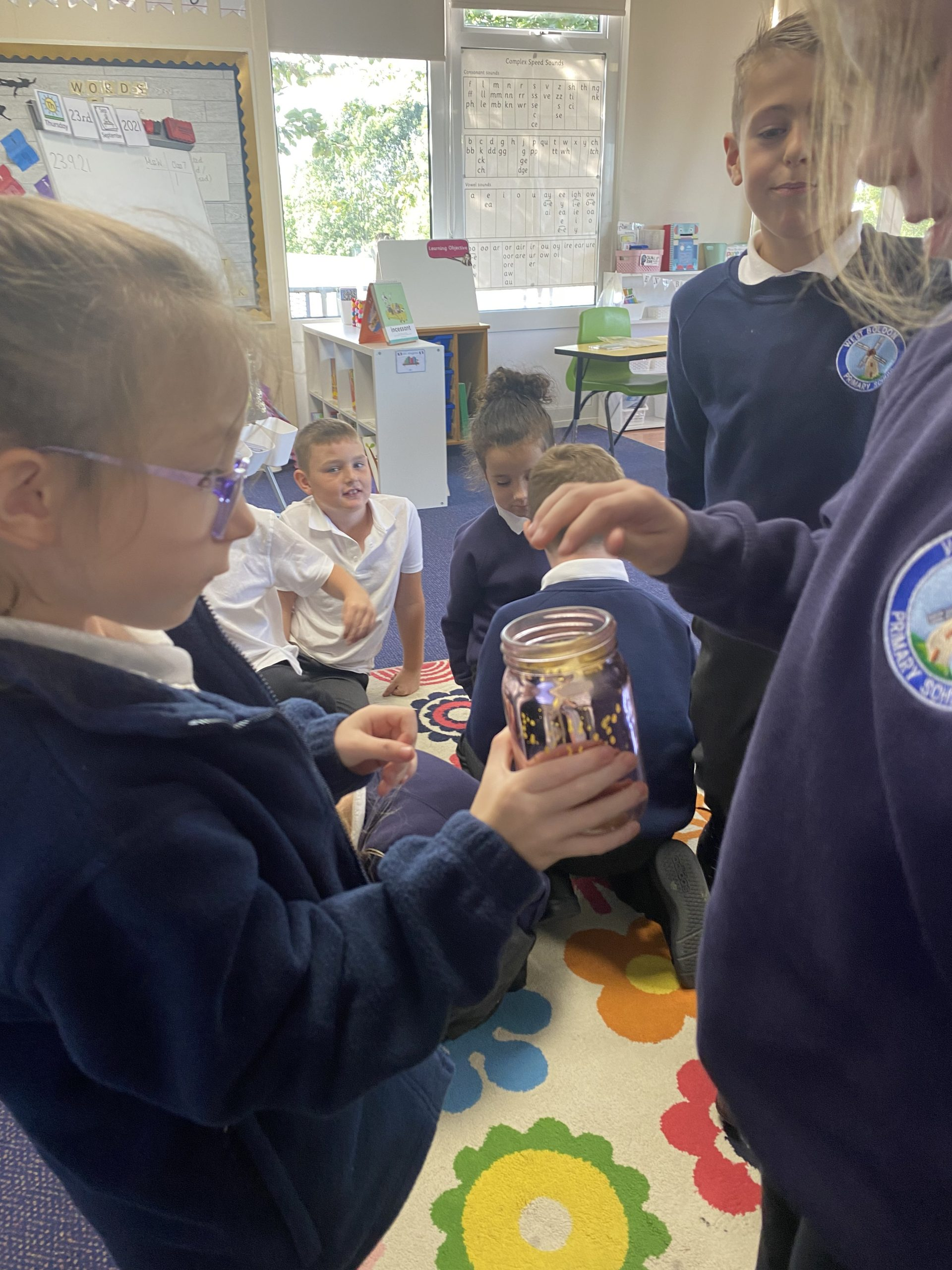 Year 3 putting their secrets in the secret jar