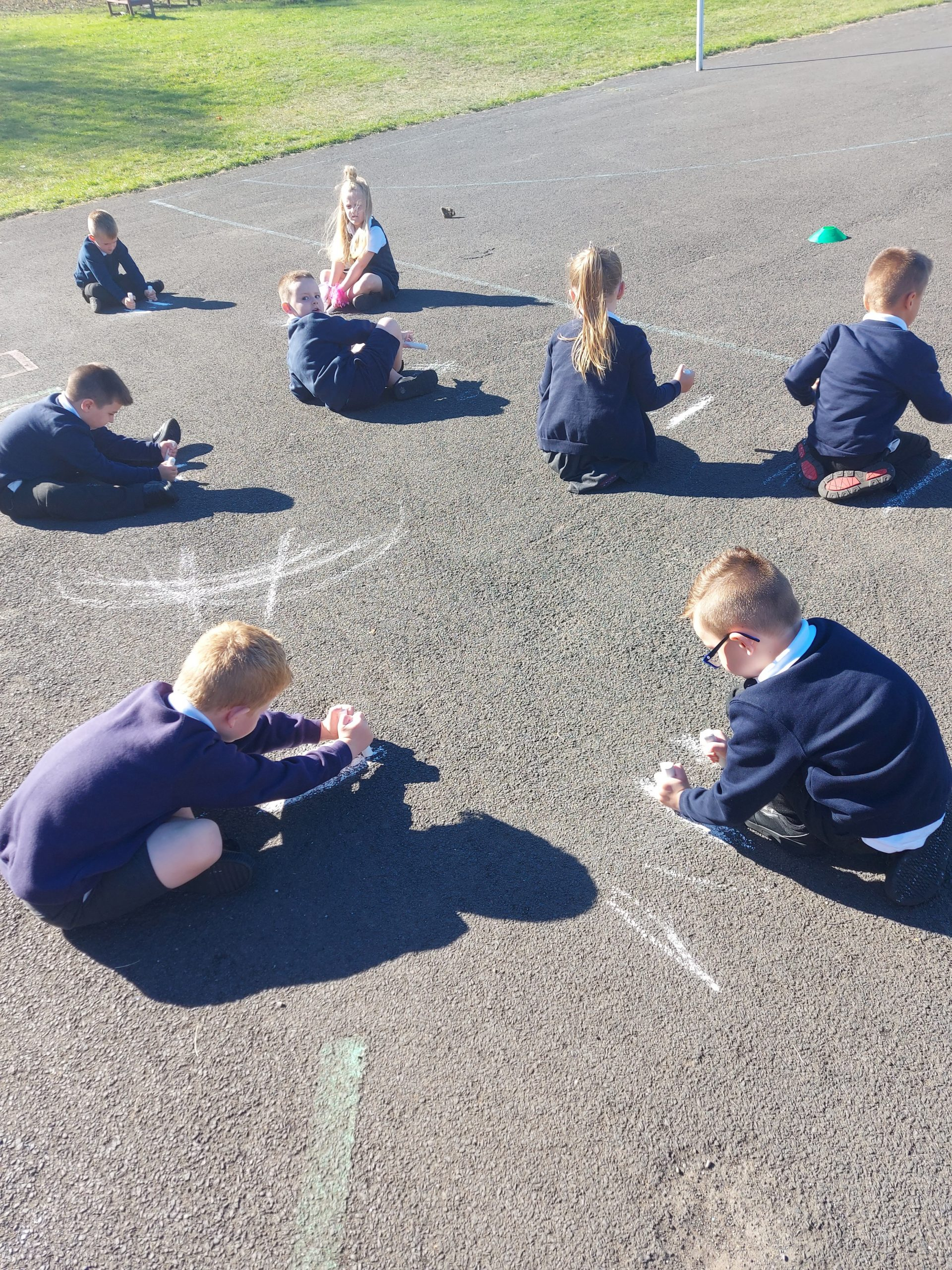 Year 1 squiggling while they wiggle!