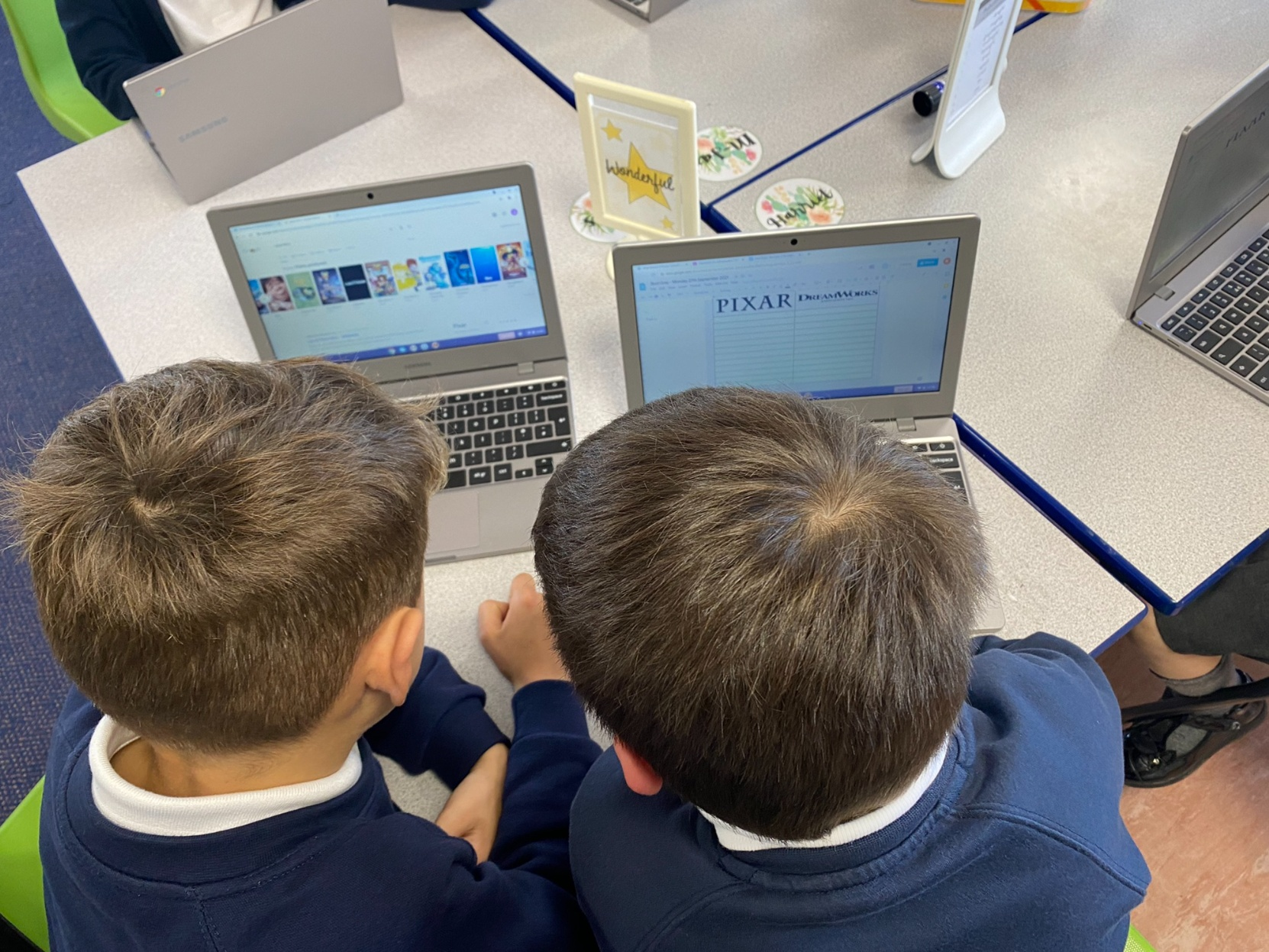 Year 3 children researching about Pixar and Dreamworks