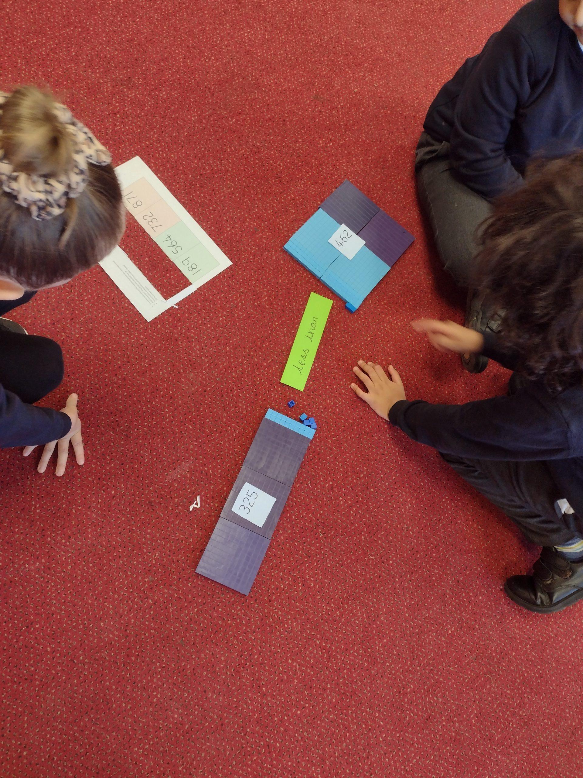 Year 3 children enjoying their practical maths lesson