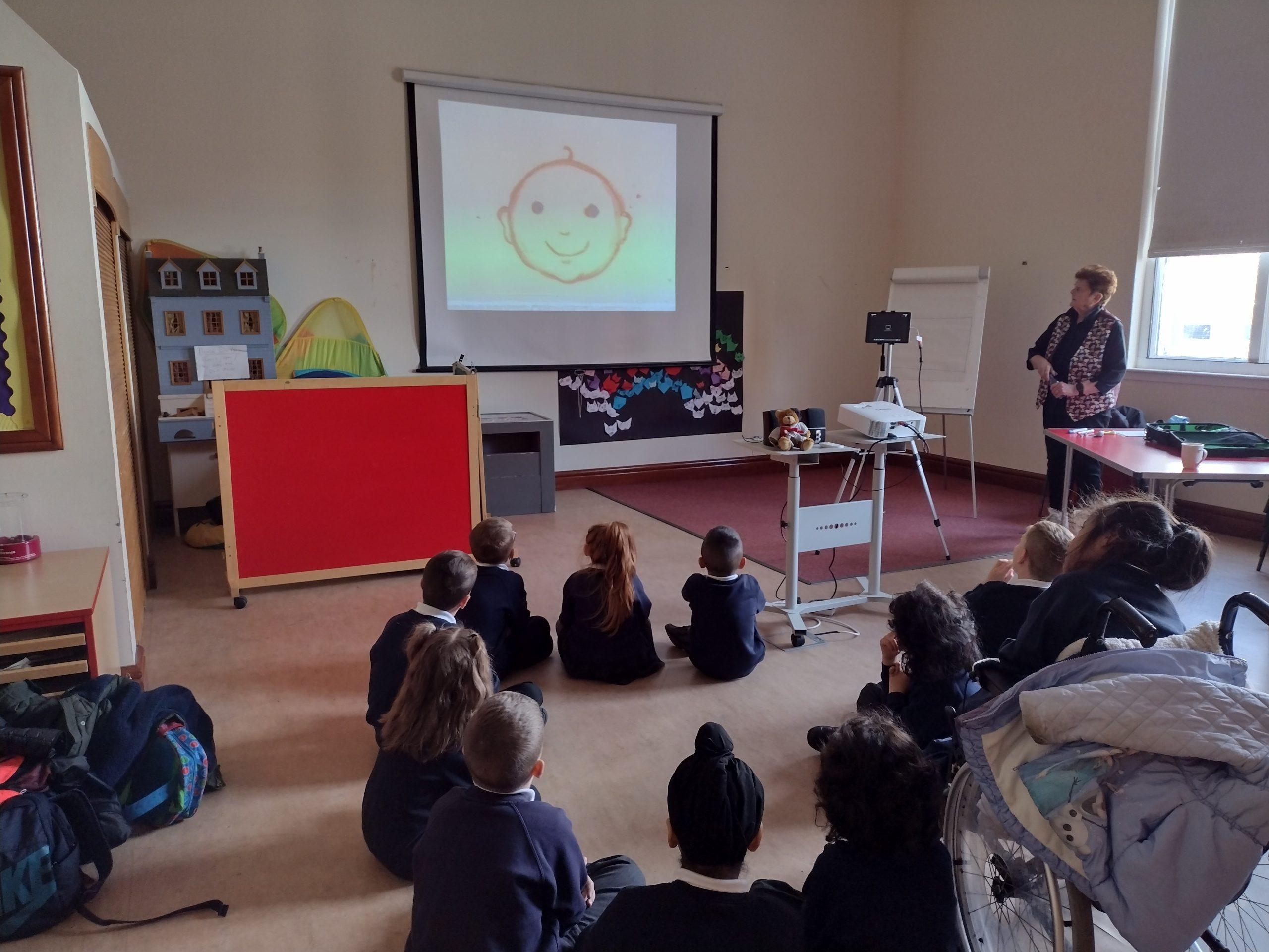 Children watching an animation by Sheila Graber