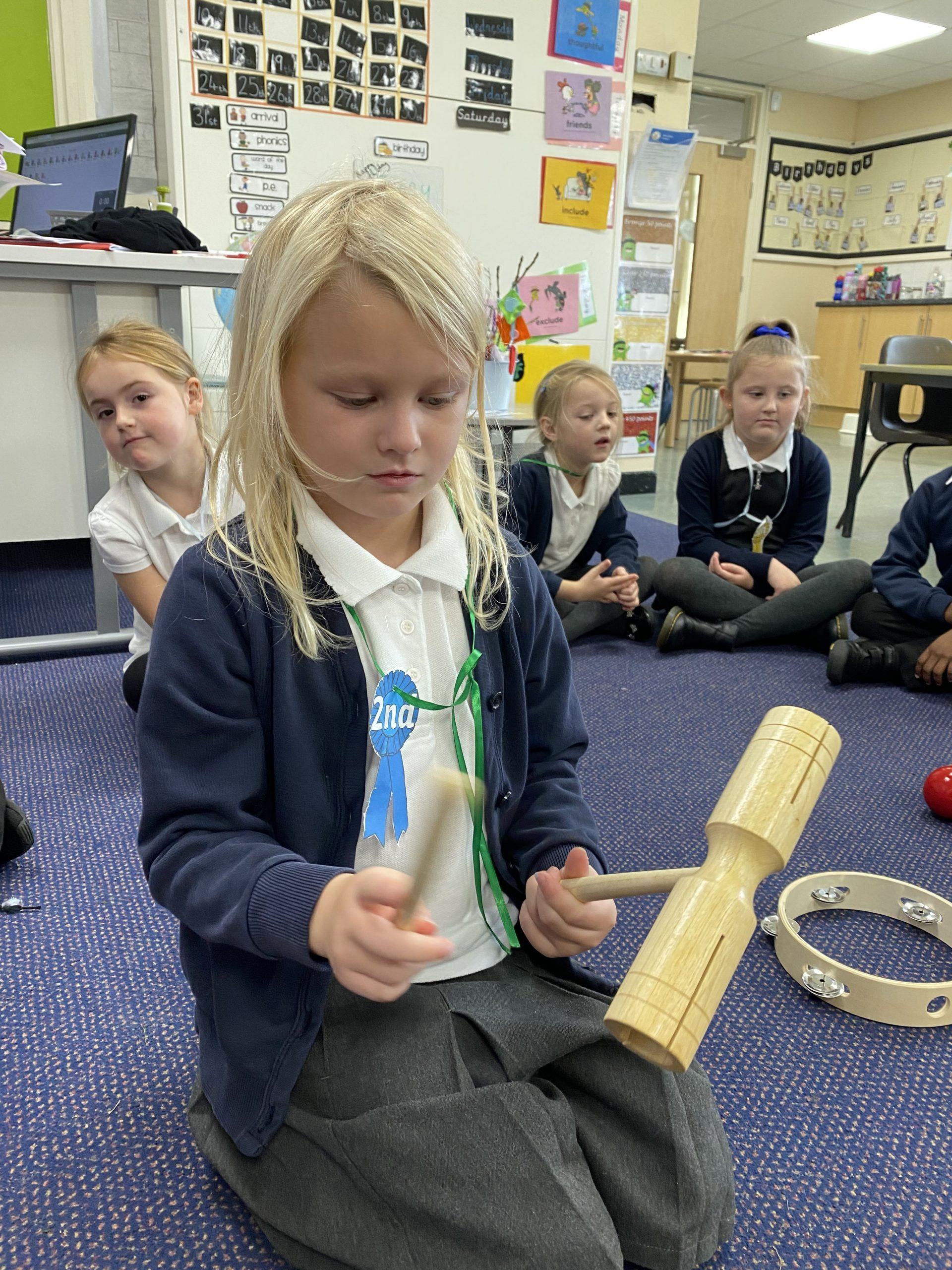 Children in Y1 making music