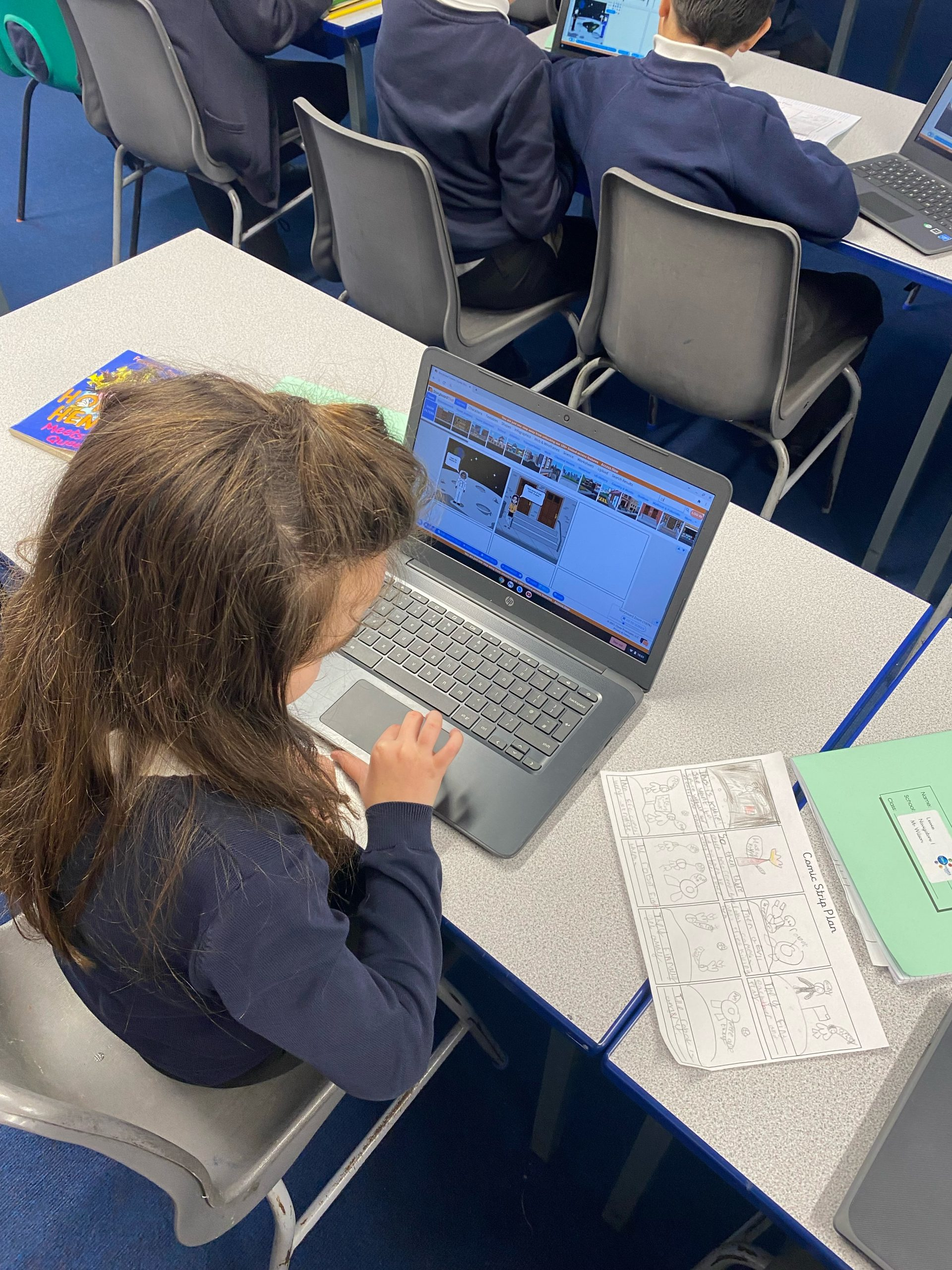Year 5 using the chromebooks to create their own comic strips